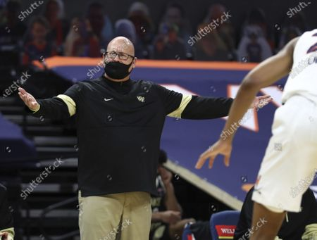 Wake Forest coach Steve Forbes reacts to a play during the team's NCAA college basketball game against Virginia, in Charlottesville, Va
