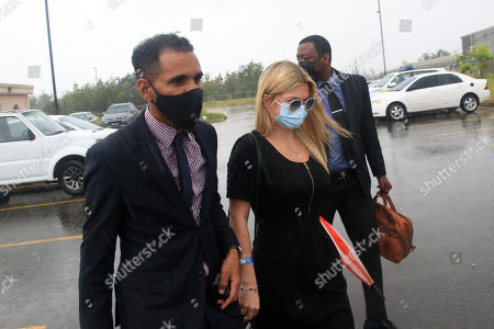 Zara Holland and one of her legal team leaving the District D Magistrates Court in Barbados. British Reality TV Star Zara Holland was this morning fined $12000.00 Barbados ( $6000.00 USD ) for breaching Barbados Corona Virus quarantine laws when she appeared in the District D magistrate court