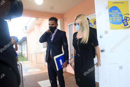 Stock Photo of Zara Holland and one of her legal team at the District D Magistrates Court in Barbados. British Reality TV Star Zara Holland was this morning fined $12000.00 Barbados ( $6000.00 USD ) for breaching Barbados Corona Virus quarantine laws when she appeared in the District D magistrate court
