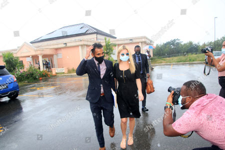Stock Picture of Zara Holland and one of her legal team leaving the District D Magistrates Court in Barbados. British Reality TV Star Zara Holland was this morning fined $12000.00 Barbados ( $6000.00 USD ) for breaching Barbados Corona Virus quarantine laws when she appeared in the District D magistrate court