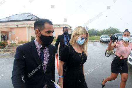 Stock Image of Zara Holland and one of her legal team leaving the District D Magistrates Court in Barbados. British Reality TV Star Zara Holland was this morning fined $12000.00 Barbados ( $6000.00 USD ) for breaching Barbados Corona Virus quarantine laws when she appeared in the District D magistrate court