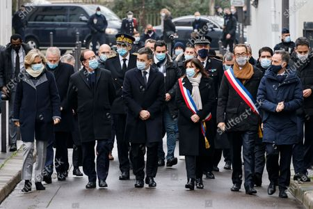 Stock Photo of (From L) President of French Ile-de-France region Valerie Pecresse, French former president Francois Hollande, French Interior Minister Gerald Darmanin and Mayor of Paris Anne Hidalgo arrive to pay their respects outside Charlie Hebdo's former offices in Paris, France, 07 January 2021, during a ceremony marking the sixth anniversary of the jihadist attack of the satirical magazine that killed 12 people. The attack on the weekly -- with its long history of mocking Islam and other religions -- was the first in a series of assaults that have claimed more than 250 lives since 07 January 2015, mostly at the hands of young French-born jihadists.