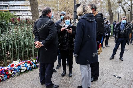 Stock Image of Nabiha Merabet (C), the sister of Ahmed Merabet, the policeman who was killed in the attacks at the offices of the Charlie Hebdo magazine, talks with French former president Francois Hollande (back, L) and President of French Ile-de-France region Valerie Pecresse (back, R) in Paris, France, 07 January 2021, during a ceremony marking the sixth anniversary of the jihadist attack of the satirical magazine that killed 12 people. The attack on the weekly -- with its long history of mocking Islam and other religions -- was the first in a series of assaults that have claimed more than 250 lives since 07 January 2015, mostly at the hands of young French-born jihadists.  MAXPPP OUT