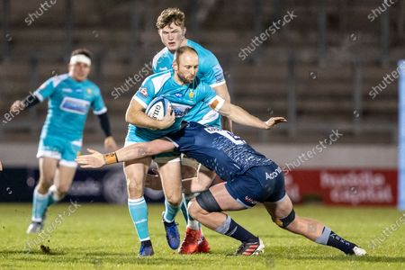Chris Pennell of Worcester Warriors is tackled by Cobus Weise of Sale Sharks; AJ Bell Stadium, Salford, Lancashire, England; English Premiership Rugby, Sale Sharks versus Worcester Warriors.