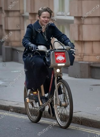 Baroness Dido Harding, Head of the NHS Test and Trace programme, cycles through Westminster.