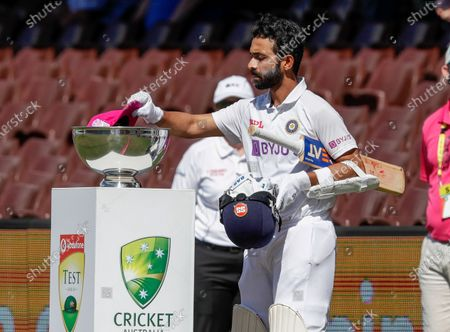 Indian captain Ajinkya Rahane places his pink cap into a bowl for Jane McGrath Day ahead of play on day three of the third cricket test between India and Australia at the Sydney Cricket Ground, Sydney, Australia