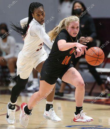 Louisville's Hailey Van Lith (10) drives past Virginia Tech's Asiah Jones, left, in the second half of an NCAA college basketball game, in Blacksburg, Va