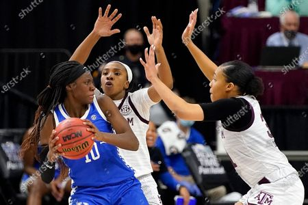 Stock Picture of Kentucky guard Rhyne Howard (10) is trapped by Texas A&M guard Aaliyah Wilson (2) and Texas A&M forward N'dea Jones (31) during the second halfof an NCAA college basketball game, in College Station, Texas