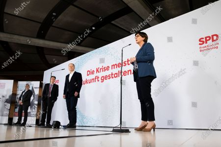 (L-R) Co-leader of the Social Democratic Party (SPD) Norbert Walter-Borjans, Bundestag faction chairman of Social Democratic Party (SPD) Rolf Muetzenich, German Minister of Finance Olaf Scholz and Co-leader of the Social Democratic Party (SPD) Saskia Esken during a joint press statement at the German parliament Bundestag in Berlin, Germany, 08 January 2021. Leaders of SPD hold a digital closed meeting to discuss current issues of the party.