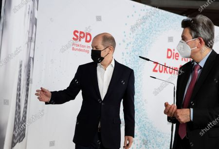 German Minister of Finance Olaf Scholz (L) and Bundestag faction chairman of Social Democratic Party (SPD) Rolf Muetzenich (R) during a joint press statement at the German parliament Bundestag in Berlin, Germany, 08 January 2021. Leaders of SPD hold a digital closed meeting to discuss current issues of the party.
