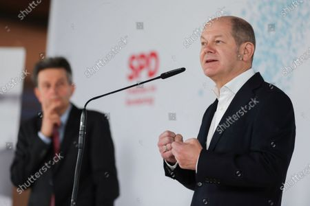Bundestag faction chairman of Social Democratic Party (SPD) Rolf Muetzenich (L) and German Minister of Finance Olaf Scholz (R) during a joint press statement at the German parliament Bundestag in Berlin, Germany, 08 January 2021. Leaders of SPD hold a digital closed meeting to discuss current issues of the party.