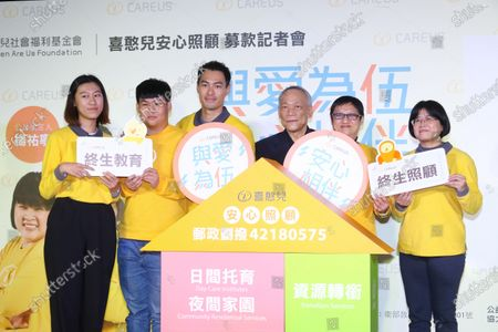 Stock Picture of Tony Yang attends a charity activity to call on people take care of the mentally handicapped people.