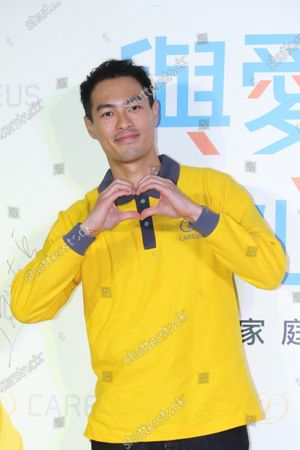 Stock Image of Tony Yang attends a charity activity to call on people take care of the mentally handicapped people.
