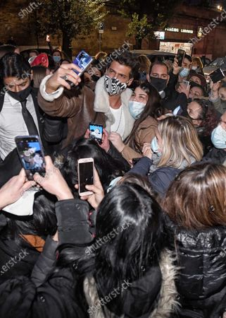 Stock Photo of Can Yaman with fans.