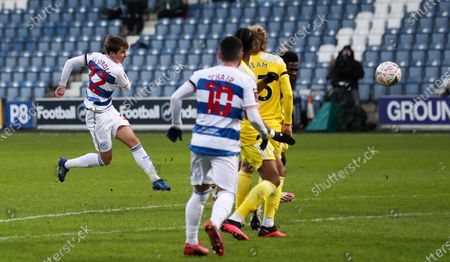 Tom Carroll of QPR  volleys a shot from the edge of the box just before half time
