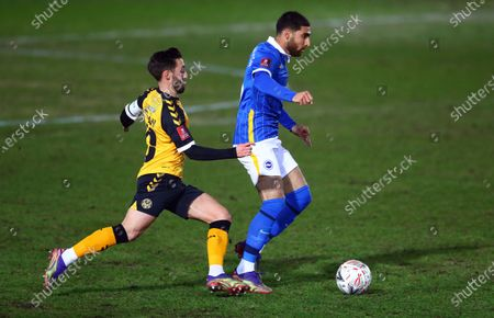 Alireza Jahanbakhsh and Hove Albion  and Josh Sheehan of Newport County in action