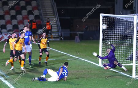 Tom King of Newport County makes a great save from an acrobatic effort on goal by Andi Zeqiri of Brighton and Hove Albion