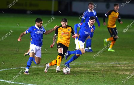 Scot Bennett of Newport County and Alireza Jahanbakhsh and Hove Albion in action