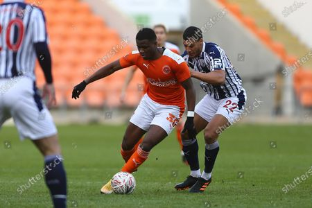 Stock Picture of Blackpool's Bez Lubala and West Brom's Lee Peltier