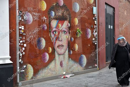 Tributes at the mural in Brixton for David Bowie on what would have been his 74th birthday