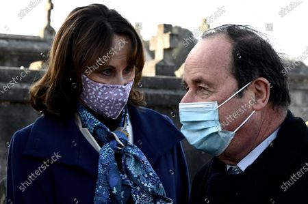 Former French minister Segolene Royal (L) and President Francois Hollande (R) speak as they attend a tribute ceremony at the tomb of former President Francois Mitterrand marking the 25th anniversary of his death, on in the cemetery of Jarnac, central western France