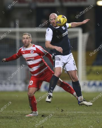 Charlie Adam of Dundee challenges for the ball with Lee Currie of Bonnyrigg Rose Athletic; Dens Park, Dundee, Scotland; Scottish Cup Football, Dundee FC versus Bonnyrigg Rose Athletic.