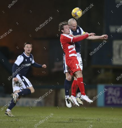 Stock Photo of Charlie Adam of Dundee competes in the air with Scott Gray of Bonnyrigg Rose Athletic; Dens Park, Dundee, Scotland; Scottish Cup Football, Dundee FC versus Bonnyrigg Rose Athletic.