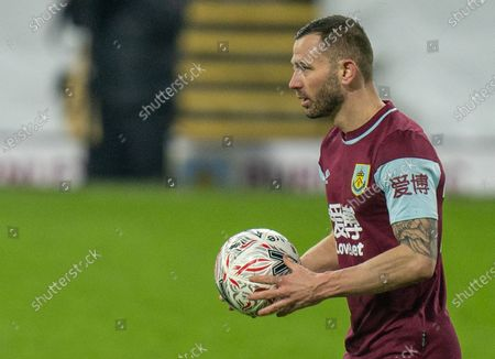 Phil Bardsley steps up to take the winning penalty and put Burnley into the next round; Turf Moor, Burnley, Lanchashire, England; English FA Cup Football, Burnley versus Milton Keynes Dons.