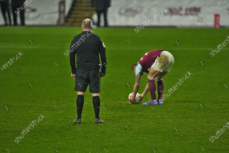 Stock Image of Phil Bardsley steps up to take winning penalty and slots in low left to take Burnley into the next round; Turf Moor, Burnley, Lanchashire, England; English FA Cup Football, Burnley versus Milton Keynes Dons.