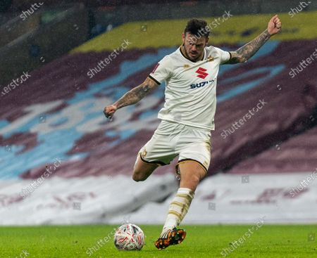 Ben Gladwin of MK Dons strikes and hits the post in extra time; Turf Moor, Burnley, Lanchashire, England; English FA Cup Football, Burnley versus Milton Keynes Dons.