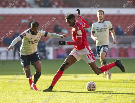 Sammy Ameobi of Nottingham Forest stops with the ball at his feet in front of Leandro Bacuna of Cardiff City; City Ground, Nottinghamshire, Midlands, England; English FA Cup Football, Nottingham Forest versus Cardiff City.