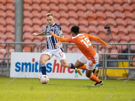 Kamil Grosicki of West Bromwich Albion is tracked by Grant Ward of Blackpool; Bloomfield Road, Blackpool, Lancashire, England; English FA Cup Football, Blackpool versus West Bromwich Albion.