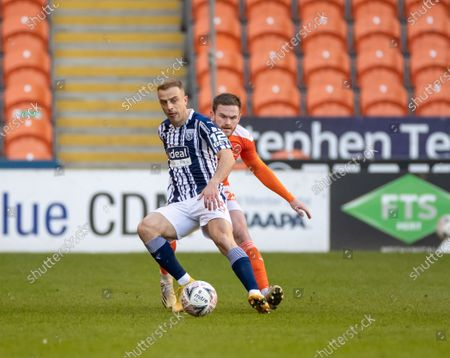 Kamil Grosicki of West Bromwich Albion tracked by Daníel Grétarsson of Blackpool; Bloomfield Road, Blackpool, Lancashire, England; English FA Cup Football, Blackpool versus West Bromwich Albion.