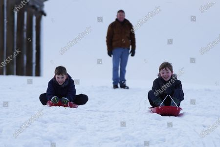 Williams Downs,9, and Aaron Downs,9, enjoy sledging in the snow at Hardwick County Park in Darlington.The Met Office issues yellow weather warning of snow and ice that will be affecting many parts of the UK for today.Photo credit: Ioannis Alexopoulos/LNP