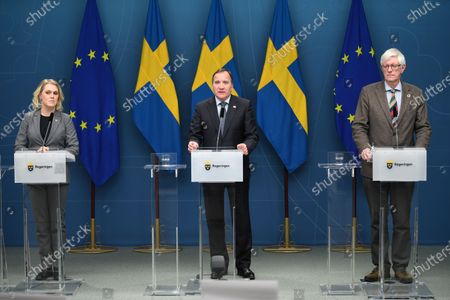 Minister of Social Affairs Lena Hallengren (L) Prime Minister Stefan Lofven (C) and the Swedish Public Health Agency's Secretary General Johan Carlsson (R) at a press conference regarding a temporary pandemic law, which was adopted in the parliament on Friday Jan. 8, 2021.