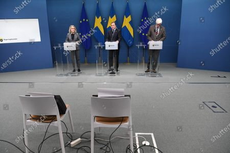 Stock Photo of Minister of Social Affairs Lena Hallengren (L) Prime Minister Stefan Lofven (C) and the Swedish Public Health Agency's Secretary General Johan Carlsson (R) at a press conference regarding a temporary pandemic law, which was adopted in the parliament on Friday Jan. 8, 2021.
