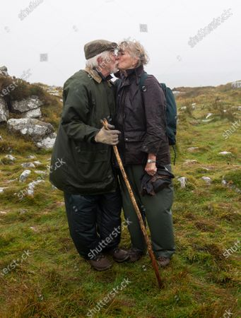 Robin Hanbury-Tenison pictured kissing his wife Louella and celebrating at the summit of Brown Willy 1378ft above sea level on on Bodmin Moor. 