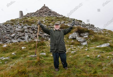 Stock Photo of Robin Hanbury-Tenison pictureda  celebrating at the summit of Brown Willy 1378ft above sea level on on Bodmin Moor. 