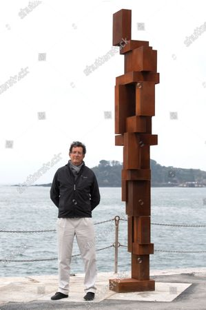 Sir Antony Gormley with his latest work 'Look ll ' on West Hoe Pier, Plymouth.