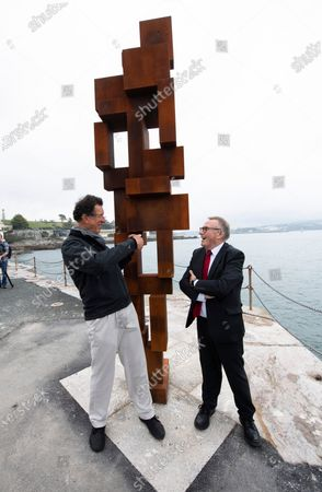 Sir Antony Gormley with his latest work 'Look ll ' and Tudor Evans leader of plymouth Council at West Hoe Pier, Plymouth.