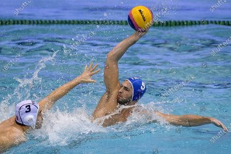 Giannis Fountoulis (R) of Greece is challenged by Marion Vernoux of France during the Men's Water Polo World League European qualifications' quarter final match France vs Greece in Debrecen, Hungary, 08 January 2021.