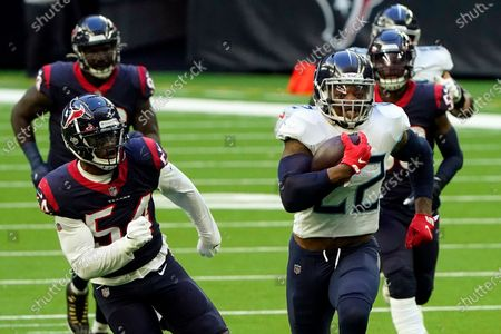 Tennessee Titans running back Derrick Henry (22) runs for a touchdown as Houston Texans' Jacob Martin (54) chases during the first half of an NFL football game in Houston. The Titans play the Baltimore Ravens in a wild-card playoff game on Sunday