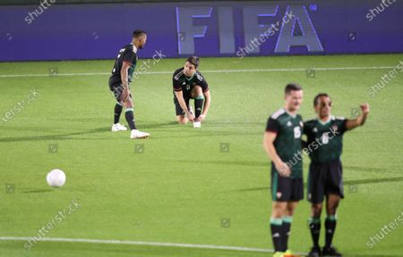 Stock Image of Manchester United legend Patrice Evra (L) talks to former Manchester City player Samir Nasri (2-L) during an exhibition soccer match played by FIFA president Gianni Infantino and International legend players including Emiratis players and UAE officials in Gulf emirate of Dubai, United Arab Emirates, 08 January 2021.