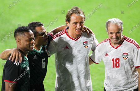 Stock Image of (L-R) Manchester United legend Patrice Evra, Turkish chef Nusret Gokce 'Salt Bae', Italian national soccer team head coach Roberto Mancini and Saeed Hareb, Secretary General of Dubai Sports Council, attend an exhibition soccer match played by International legend players including Emiratis players and UAE officials in Gulf emirate of Dubai, United Arab Emirates, 08 January 2021.