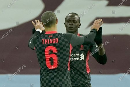 Sadio Mane of Liverpool (R) celebrates scoring his team's third goal during the English FA Cup third round match between Aston Villa and Liverpool in Birmingham, Britain, 08 January 2021.