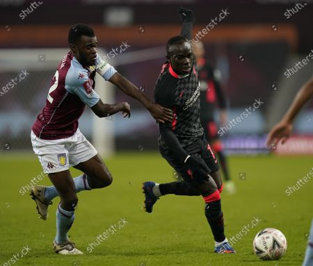 Dominic Revan of Aston Villa (L) in action against Sadio Mane of Liverpool (R) during the English FA Cup third round match between Aston Villa and Liverpool in Birmingham, Britain, 08 January 2021.