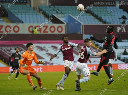 Sadio Mane of Liverpool (R) misses a chance to score during the English FA Cup third round match between Aston Villa and Liverpool in Birmingham, Britain, 08 January 2021.