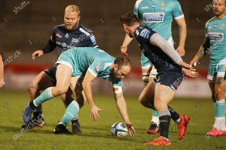 Chris Pennell of Worcestor collects a loose ball under pressure from Sales Akker Van Der Merwe during the Gallagher Premiership Rugby match between Sale Sharks and Worcester Warriors at the AJ Bell Stadium, Eccles