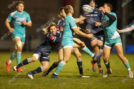 Chris Pennell of Worcestor and Faf De Klerk of Sale battle for the ball during the Gallagher Premiership Rugby match between Sale Sharks and Worcester Warriors at the AJ Bell Stadium, Eccles