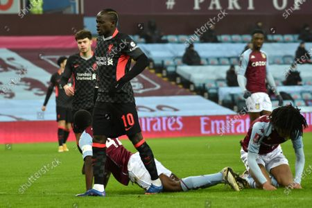 Liverpool's Sadio Mane, left, celebrates after scoring his side's first goal during the FA Cup 3rd round soccer match between Aston Villa and Liverpool at Villa Park stadium in Birmingham, England